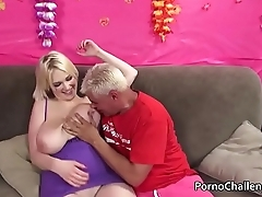 Huge natural boobed blonde eats a cumshot
