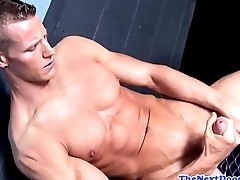 Buffed sportive athlete in solo masturbation