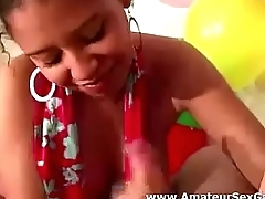 Black amateur sucking cock in party game group sex