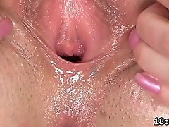 Lovesome chick is gaping soft cunt in close up and having orgasm